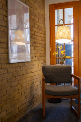 Waiting area with brick wall and gray chair